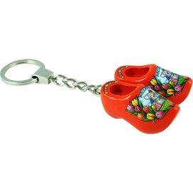 Keychain 2 shoes, orange kissing couple